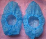 Tampa azul descartável agora tecida da sapata dos PP