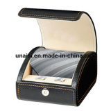 O laço do couro artificial carreg a caixa da gravata do caso para o presente