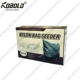 拡散機か肥料または殺虫剤ナイロン袋の種取り機のクランクを手で回しなさい