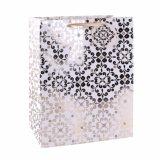 Sac de papier de cadeau de supermarché de vêtement d'or de configuration de fleur