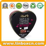 Contenitore a forma di di stagno del cioccolato al latte del cuore romantico per il giorno del biglietto di S. Valentino
