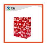 Los Copos de Nieve laminado y Feliz Navidad en papel impreso bolsa de regalo