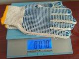7g a coloré des points de PVC sur les gants tricotés par coton de paume