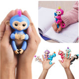 Cadeaux interactifs de jouet de bride de fixation de mouvement de doigt de son de singe de bébé de poissons jeunes