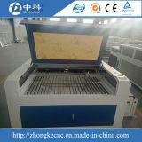 Ruida最新のシステムが付いているチーナンの工場価格の二酸化炭素ファブリック布レーザーの彫版機械