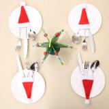 De kleine Vorken van de Houder van het Bestek van de Kappen van Kerstmis behandelen de MiniHoed van de Kerstman