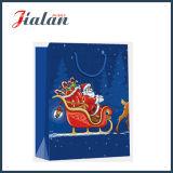 Papier brillant de l'art laminé la veille de Noël Shopping sac de papier cadeau