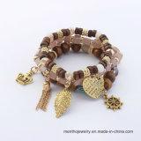 Retro braccialetti etnici del branello di tendenze dei monili di costume di modo del braccialetto di figura di fogli