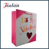 ロゴによって印刷されるカスタムバレンタインの`S日Womansは紙袋を運ぶ