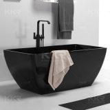 Kkr personnalisé de la résine de forme ovale noir Pierre baignoire autostable