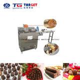 Mini macchina dell'abbigliatore del cioccolato