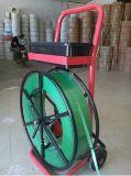 Dispensador movible de la bobina con la caja de herramientas