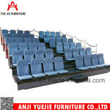 Asentar y mover hacia atrás la silla plegable Yj001s del estadio del baloncesto