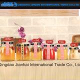 Il vaso di vetro di qualità superiore per miele, l'ostruzione, alimento, marina il prezzo più basso delle bottiglie di vetro
