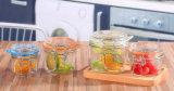 台所用品のクリップ蛇口が付いているガラス食糧記憶の瓶