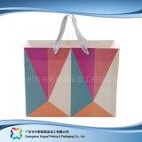 Sac de transporteur de empaquetage estampé de papier pour les vêtements de cadeau d'achats (XC-bgg-025)