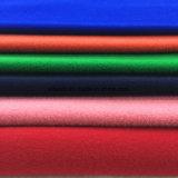 Aplicar toda la tela de las lanas con brocha de los colores con la tela lista de Greige