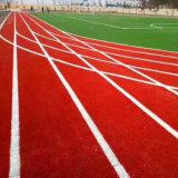 Tappeto erboso falso sintetico del prato inglese della pista dell'erba artificiale corrente atletica del campo