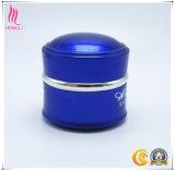 空の美の濃紺クリーム色の包装の瓶の装飾的な容器