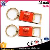 Keychain in lega di zinco apri di bottiglia dell'oro di promozione con il marchio a resina epossidica