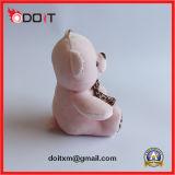 Juguete rosado del animal doméstico de la felpa con el leopardo Bowtie