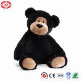 Face mignonne d'ours noir semblant le jouet mou bourré de peluche