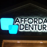 3D Halo Lit Black Painted Stainless Steel LED Sign