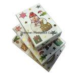 عيد ميلاد المسيح ورقيّة يعبّئ صندوق