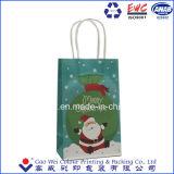 Sacco di carta bianco su ordinazione di Buon Natale del mestiere del Kraft di basso costo, sacco di carta del regalo