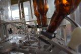 満ち、キャッピング機械を洗うガラスビンビール