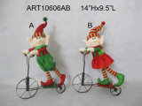 Мальчик праздника украшения рождества и велосипед металла Riding эльфа девушки
