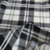 黒く及び白い小切手プリントが付いているブラシをかけられた北極の羊毛