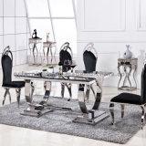 Таблица и стулы большого размера мраморный обедая