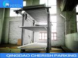 O estacionamento do carro elevador no pit para três carros