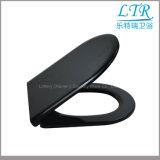 Schwarze Farben-langsamer naher Toiletten-Sitzdeckel