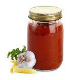 Rotondo svuotare i vasi di vetro dell'alimento della cucina della salsa dell'ostruzione con i coperchi del ferro