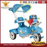 Зеленый трицикл детей черноты голубого красного цвета с парасолем