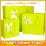 I sacchi di carta con le maniglie comerciano