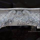 Mensola del camino di marmo con le sculture floreali, disegno francese del camino intagliata mano