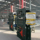 Máquina vertical de la prensa que recicla el papel usado, botellas del animal doméstico, ropa usada