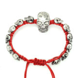 黒い赤いロープのニットの骨董品の銀によってめっきされる頭骨の調節可能なブレスレット