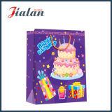 Festa de anos Candels e decorações que embalam o saco de papel do presente da compra