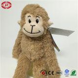 Jouet brodé pelucheux de singe de face de peluche minuscule