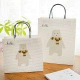 習慣はロゴによって印刷される紙袋を卸しで卸し売りする