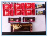 チョコレートおよびキャンデーのための自動挿入の枕食品包装機械