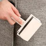 工場によってなされる小型布のクリーニングは粘着性がある粘着性があるローラーのハンドルに用具を使う