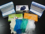 使い捨て可能で赤い粉の粉の自由なビニールの手袋