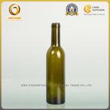 旧式な緑色小型容量の赤いガラスワイン・ボトル(1071年)