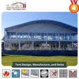 ゴルフイベントのためのGalssの壁が付いているアーチのドームの屋根の倍の三倍のデッカーのスポーツ・イベントのテント