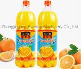 びんのオレンジジュースの充填機